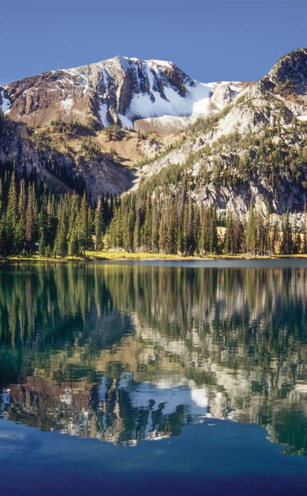 Aneroid lake is about 6 miles from the East Fork Wallowa River Trailhead. Petes Point looms above the crystal waters, which offer good trout fishing in the summer.