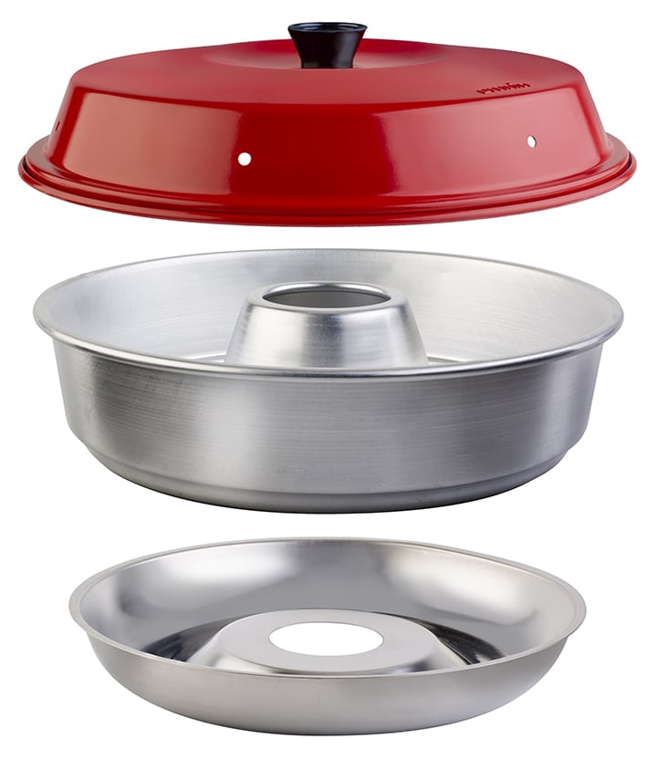 Three pieces of the Omnia oven with a red lid and silver base and center