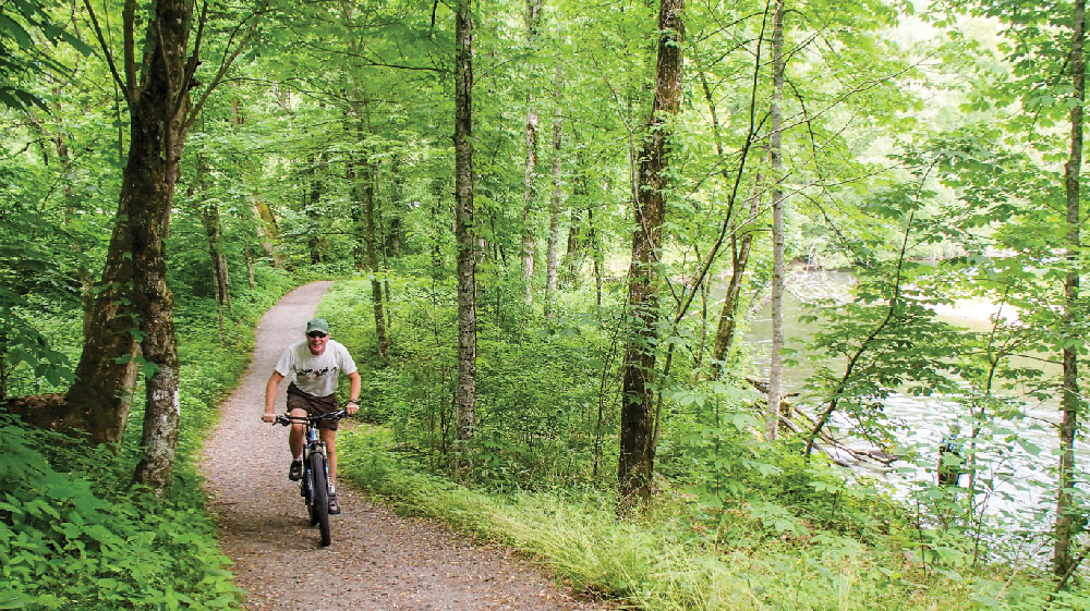 The Oconaluftee River Trail crosses the junction of Newfound Gap Road in Great Smoky Mountains National Park.