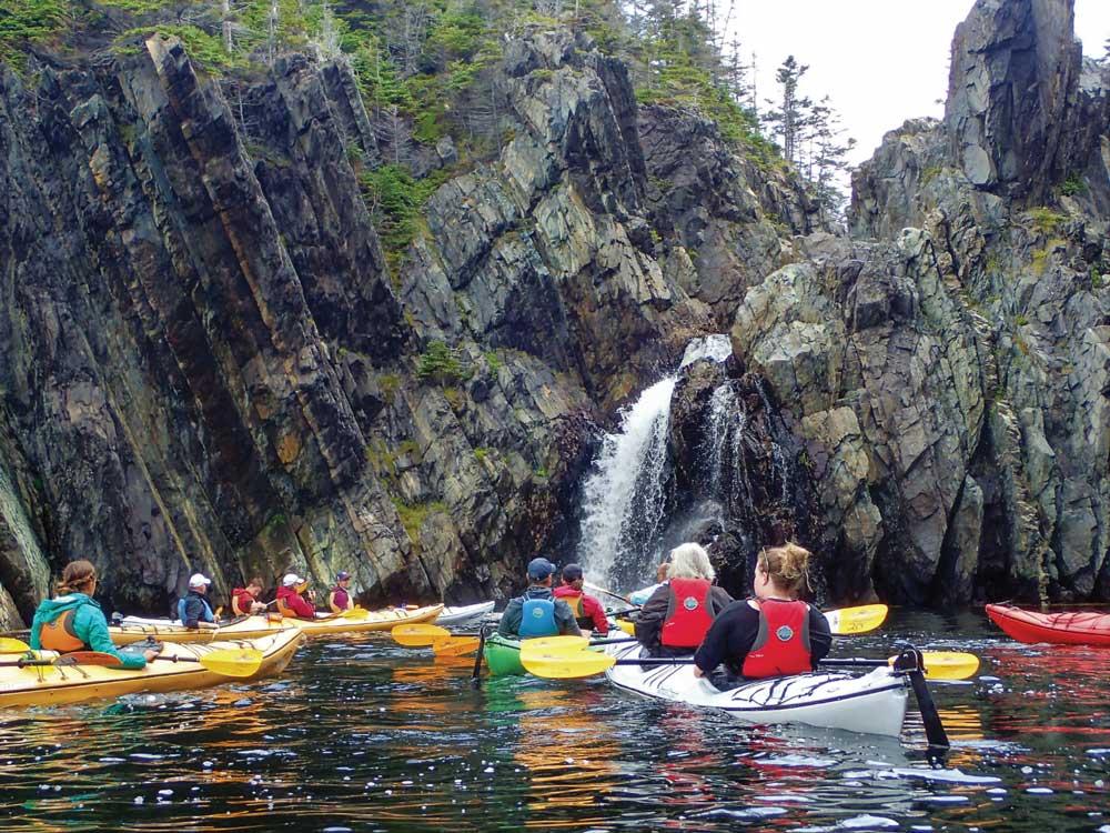 On a sea kayak tour, Stan Cook Jr. shows paddlers Cape Broyle's hidden treasures.