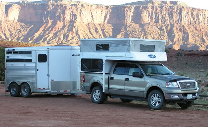 Phoenix pop-up camper on truck and towing horse trailer