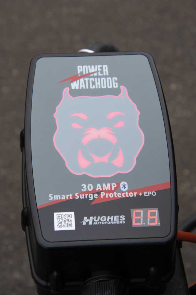 The bulldog glows red indicating the power is unsafe or out of range, and the device generates an LED error message.