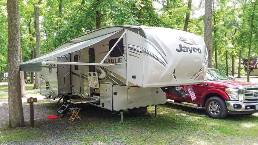 Steve Knoderer's Jayco fifth-wheel with railroad tray tray extended at campsite.