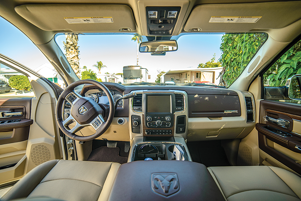 Truck dashboards have evolved into driver-control stations with large touch screens, rear-backup and cargo-bed views, voice-command features and GPS navigation.