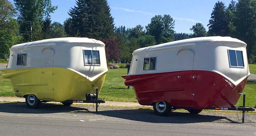 A white and yellow and a white an red Relic trailer.