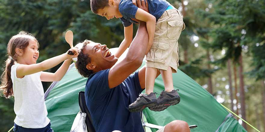 A father and kids frolic at River Run RV resort