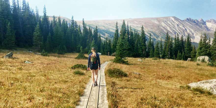 A hiker on a trail near River Run RV Resort