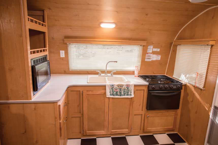 Riverside RV's Retro 199FKS has a surprisingly spacious kitchen (left) for a smaller trailer. It provides a good amount of counter and shelf space that helps to make up for the absence of overhead cabinets.