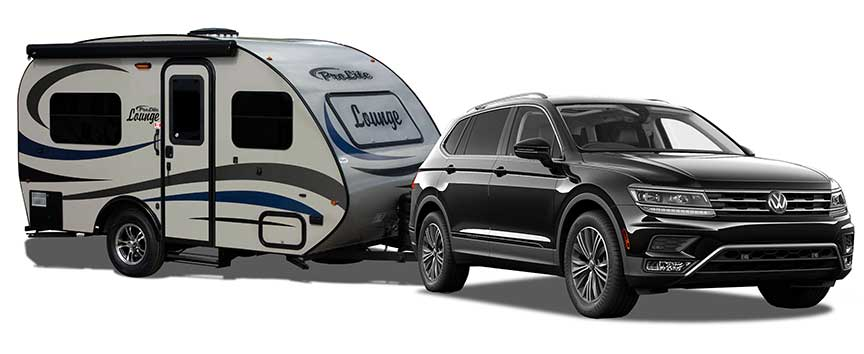 Silver Prolite Lounge trailer towed by black SUV.