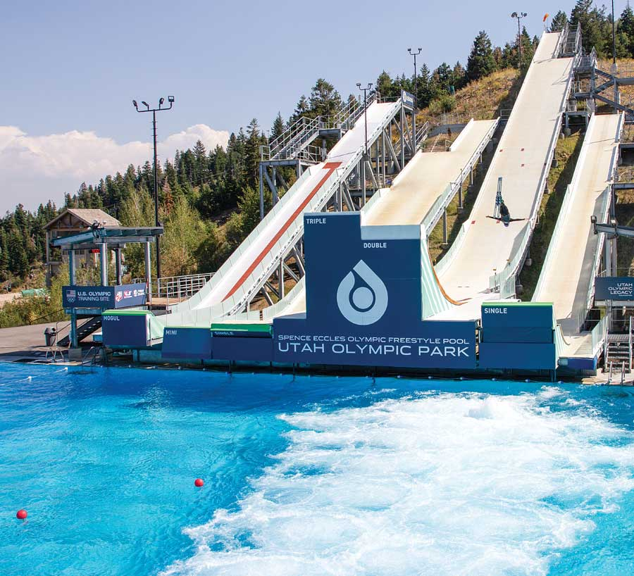 An ariel skier jumps over pool at Utah Olympic Park