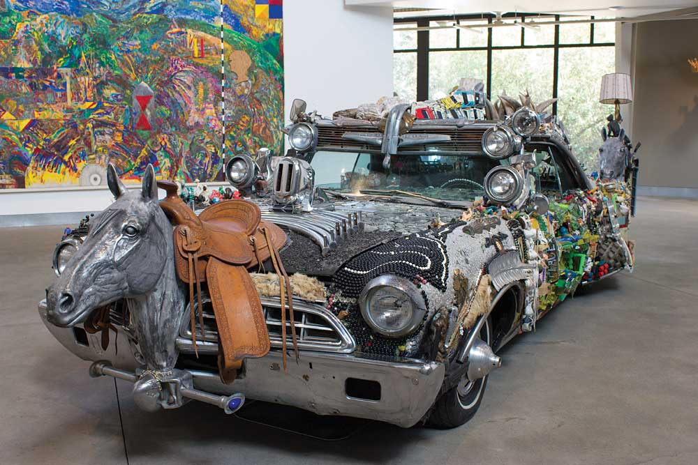 Mother Tina's Car, a 1967 Pontiac covered with a large horse head sculpture, a saddle, table lamps and a whole bunch of small trinkets, sits in the Main Gallery at di Rosa in Napa Vall
