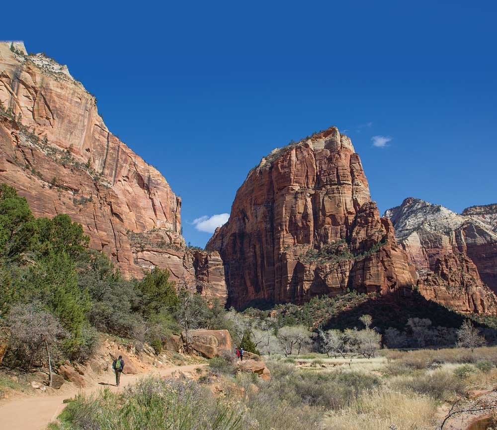 RV visit to southern Utah: A hiker is dwarfed by giant rocks on the Angel's landing hike in Zion National Park