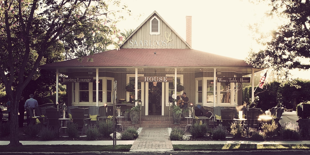 Old Victorian looking wine tasting house with front porch