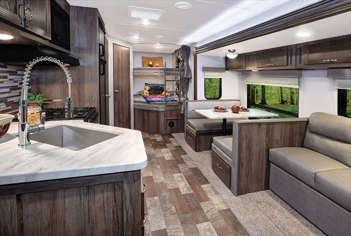 Galley, living space and double bunks inside East to West Silver Lake 27K2D travel trailer