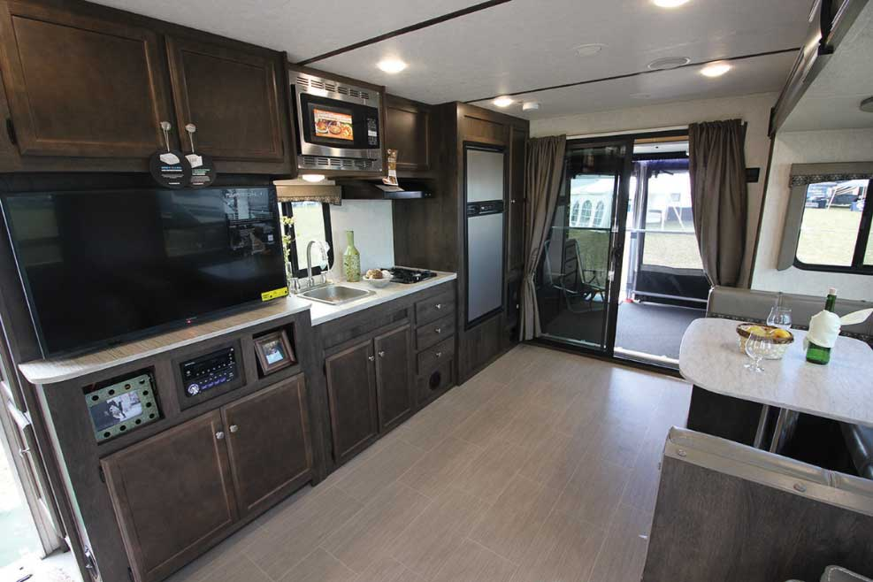 Starcraft GPS RV dining area with wooden cabinetry