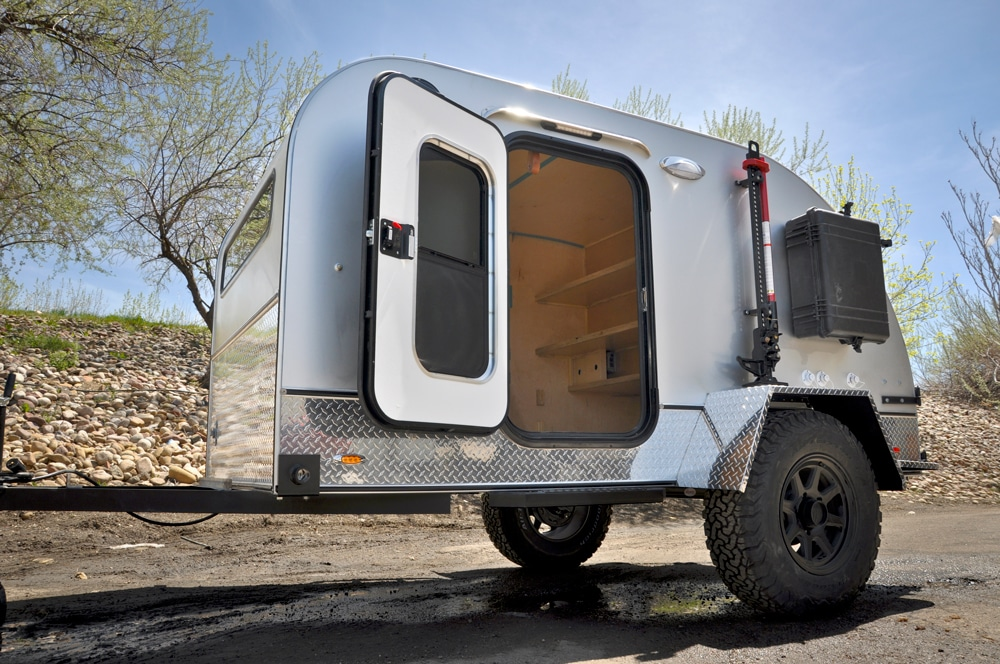 Small white camper with door open