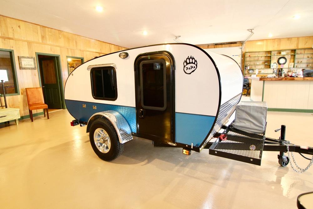White and blue designed teardrop camper inside