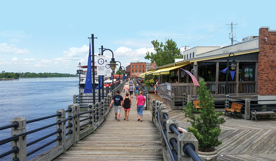 The best way to experience the magic of downtown Wilmington? Take a stroll on the 2-mile Riverwalk alongside the Cape Fear River.