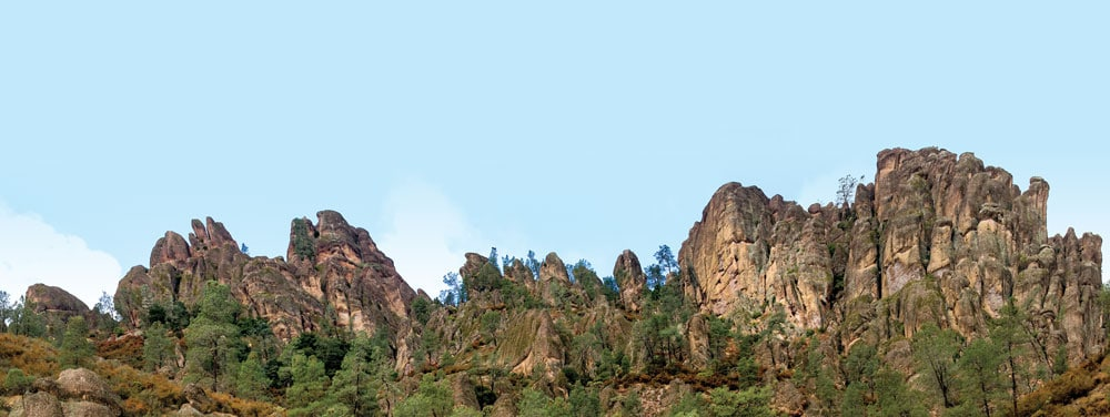 The reddish rock that dominates the cliffs and spires of the High Peaks is a form of volcanic rhyolite called breccia.