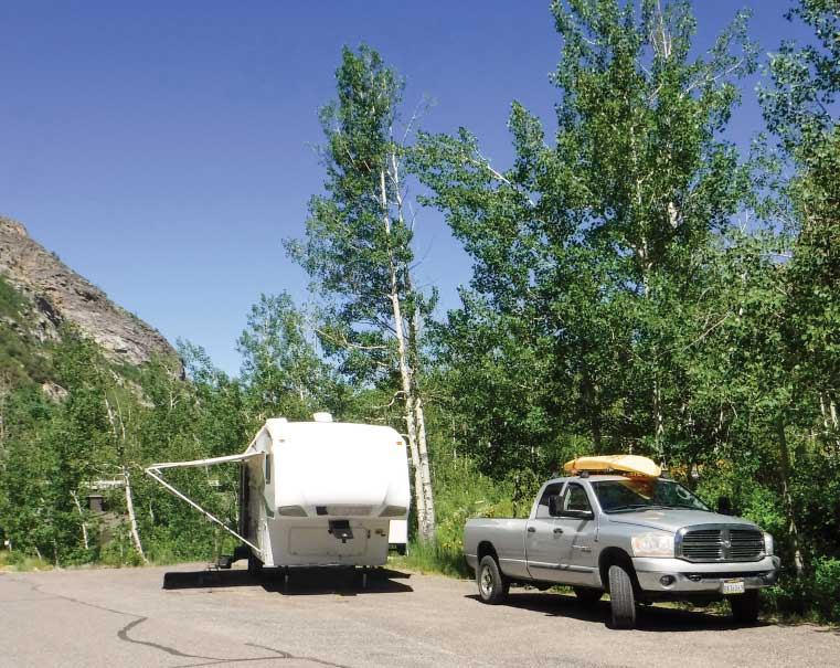 A truck and fifth-wheel trailer parked at Lamoille Canyon, Thomas Canyon Campground.