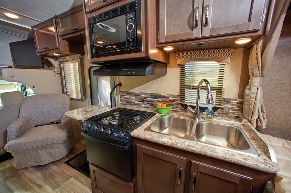 The efficient kitchen has a microwave and oven, plus continuous grates over the three-burner range. We appreciated the counter extension to the left of the range, and also the great interior lighting.