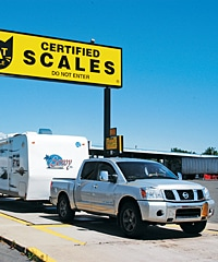 Truck pulling trailer through certified scale weigh station