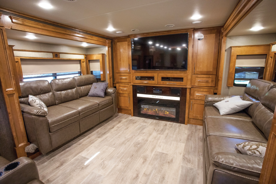 RV living area with brown leather couches