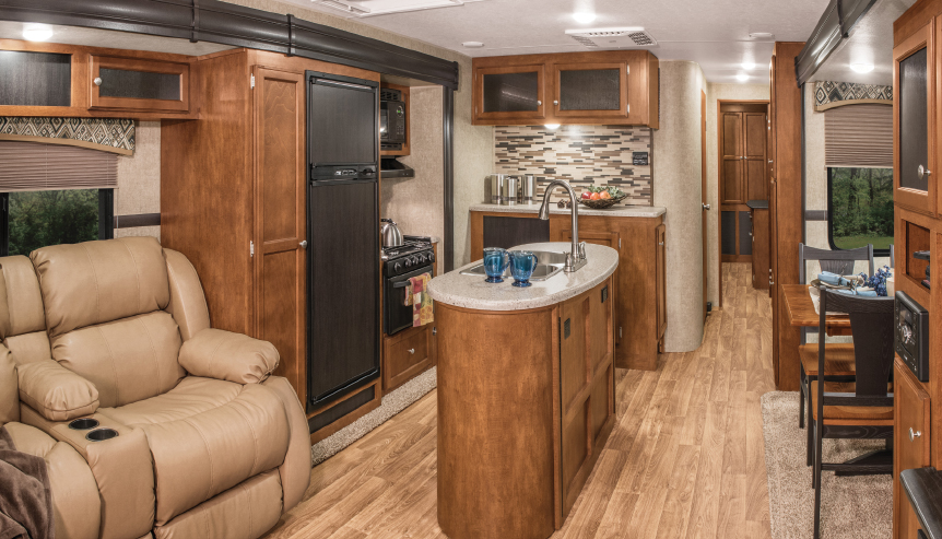 The kitchen island occupies a small portion of the vast floor space that makes up the SportTrek's galley and living room.