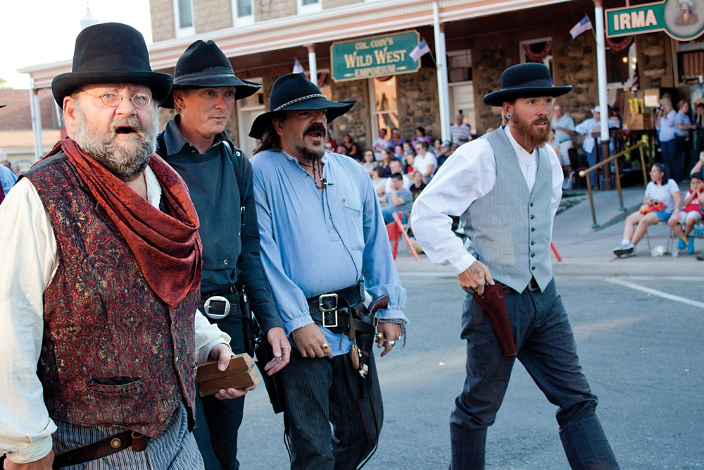 The Cody Gunfighters take to the street in front of the historic Irma Hotel with a skit performed six nights a week from June through September.