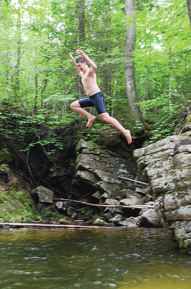 Taking the plunge into a swimming hole near the Waterville Valley's bike trail.