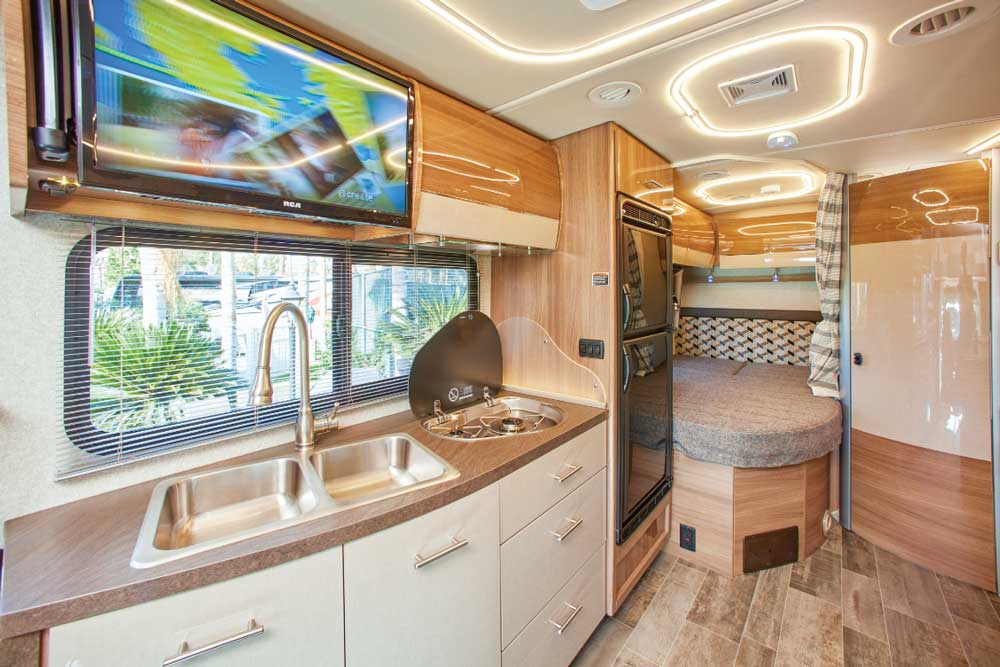 European-style cabinetry adds to the modern look inside the View. Galley is surprisingly roomy and surrounded by generous drawers and cabinets. Bed is tucked in between the passenger-side wall and corner bathroom.