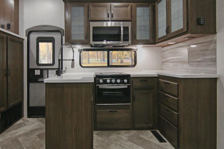 Winnebago Voyage V3436FL fifth-wheel's U-shaped kitchen