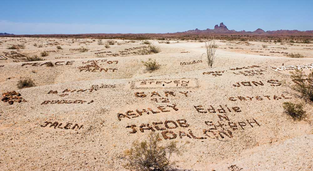 """""""Signatures"""" in the Valley of the Names on 1,200 acres of public land range from simple initials or names to more complex designs. Remember to BYOR (bring your own rocks) if you plan to leave your personal mark."""