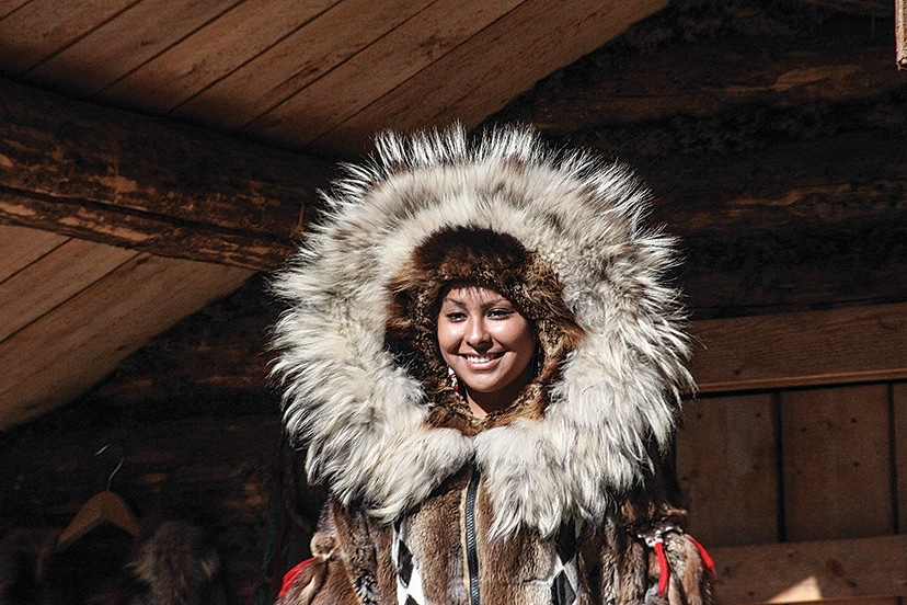 At Chena Indian Village, our guide, Janessa, shows us a typical cold-weather parka and headdress used by native Alaskans.
