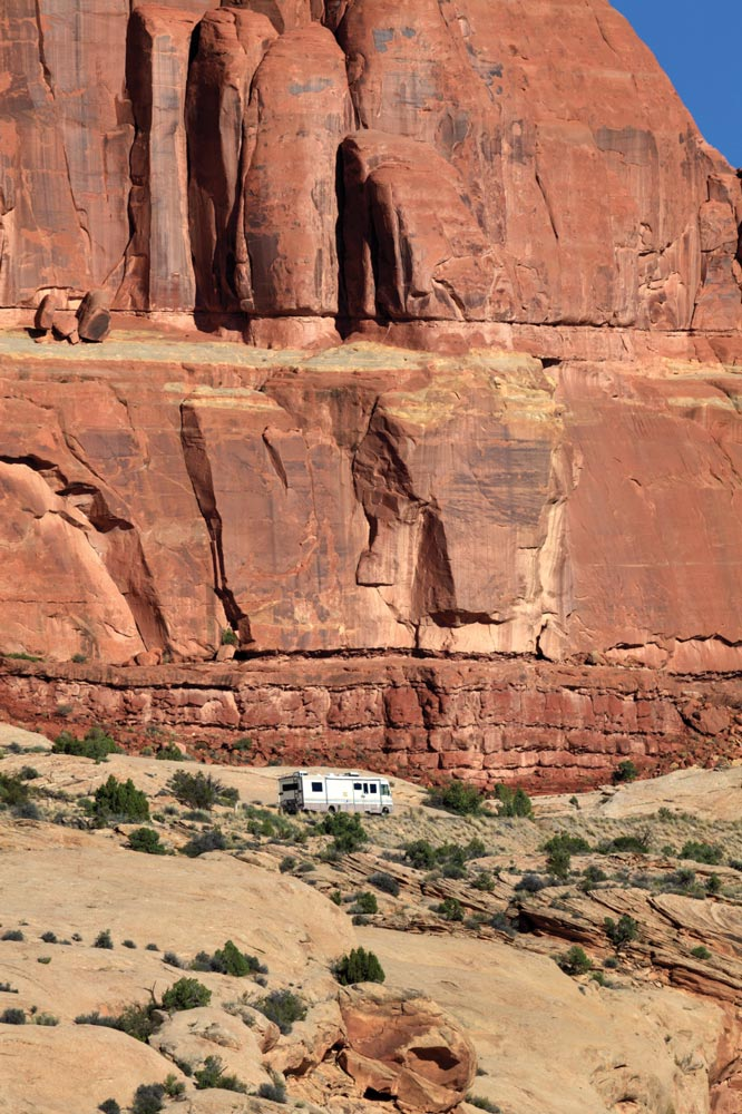 A motorhome drives along the steep start of the park road.