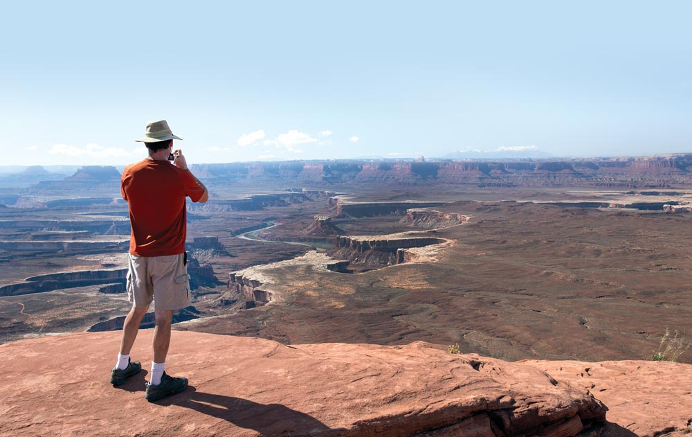 Man taking pictures at the Green River Overlook