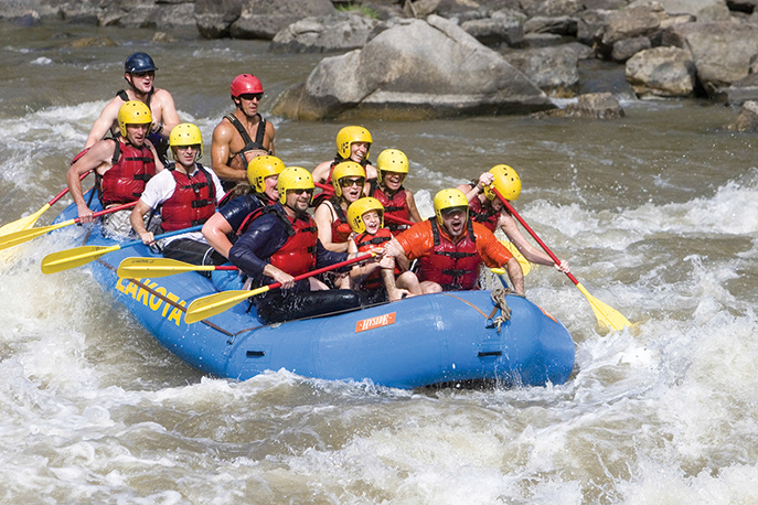 Class II and III rapids thrill rafters on the Colorado River near Kremmling.