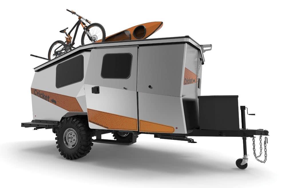 Orange and white box shaped Taxa Outdoors Cricket trailer