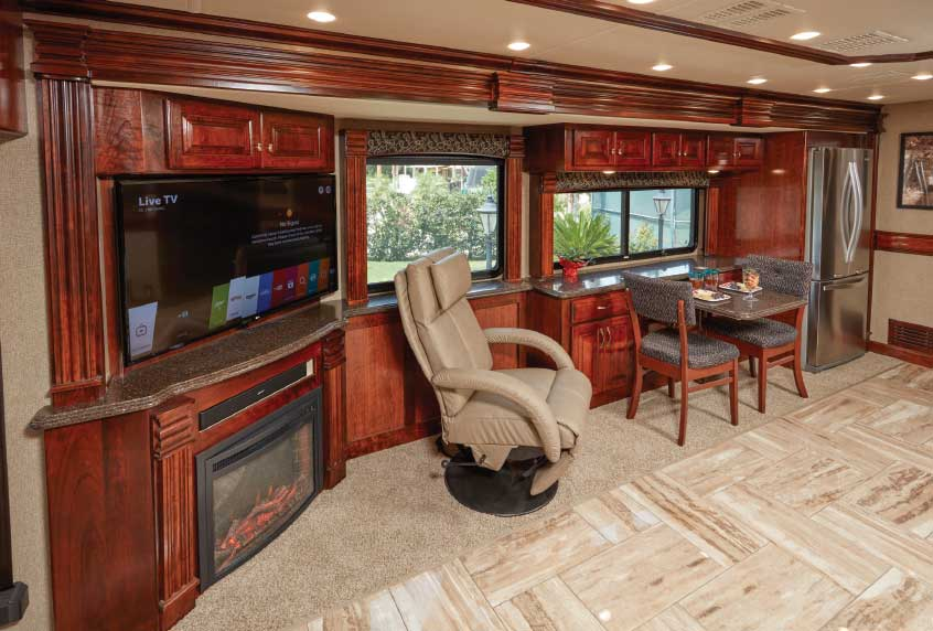 Freestanding Euro chair, placed here between the galley's entertainment center and electric fireplace and the table-for-two dinette, adds seating versatility.