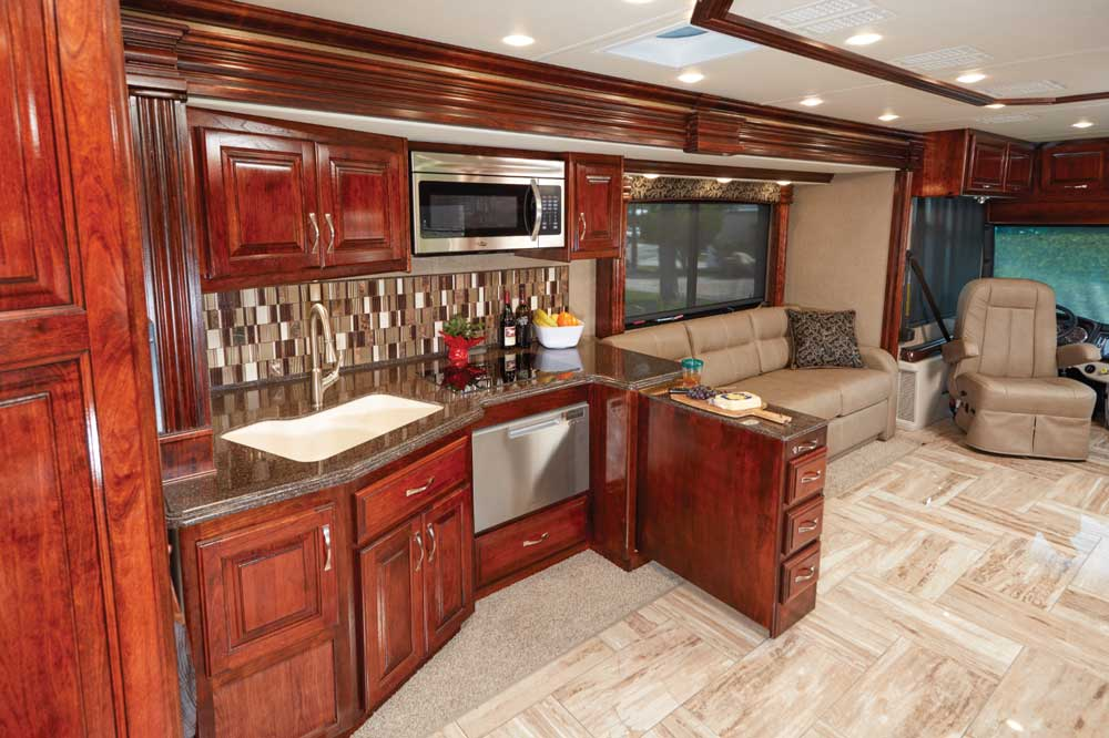 The efficient kitchen's pullout galley extension makes a handy place to keep snacks when entertaining and subtly divides the kitchen from the living area so guests aren't bumping into the cook.