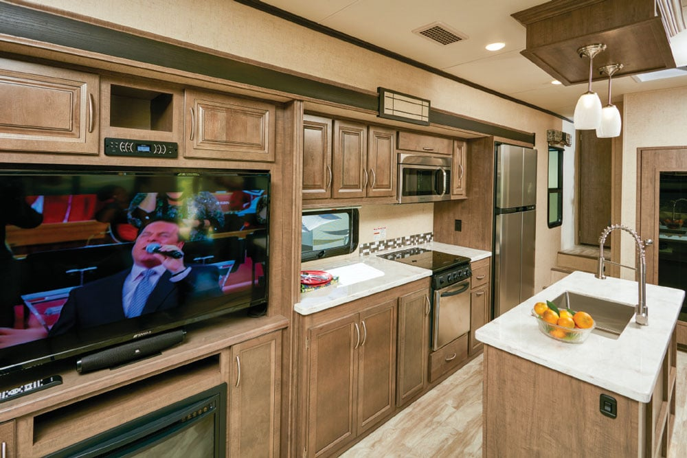 An entertainment center with a fireplace shares the slideout with a roomy galley.