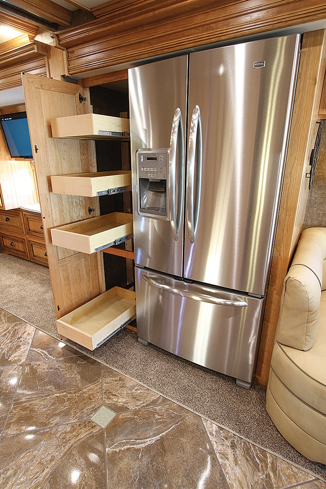 A pantry with pullout drawers is next to the 22-cubic-foot residential refrigerator/freezer.
