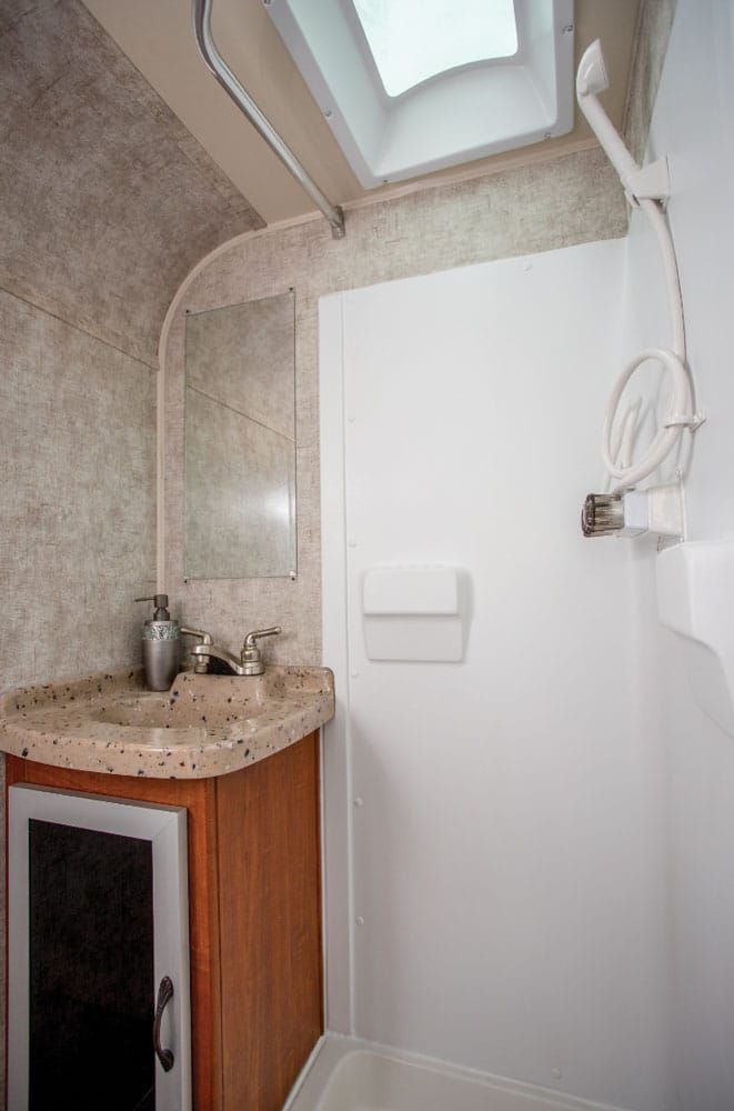 Enter the good-sized bathroom at the back of the Falcon through a free-hanging dark tempered-glass door. A large skylight over the shower adds more headroom and light.