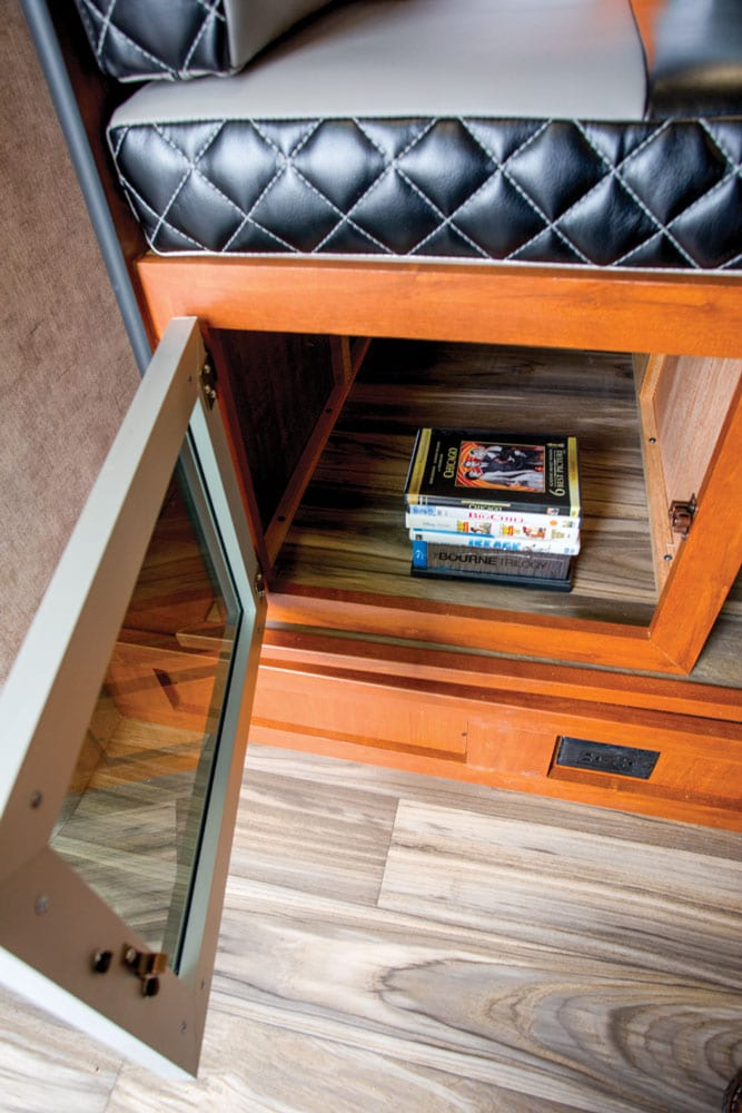 Storage under the dinette's seating passes through to the outside and can be accessed two ways from inside. Industrial-grade linoleum flooring looks like wood plank.