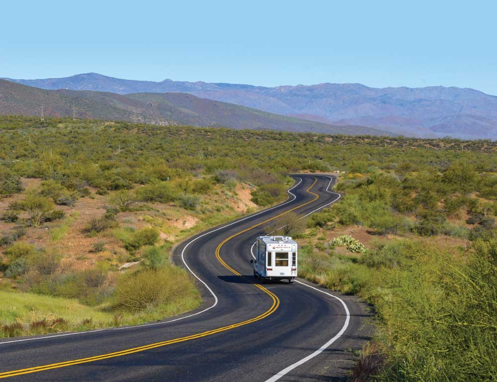 Photo of RV on curvy road demonstrates diagonal line composition.