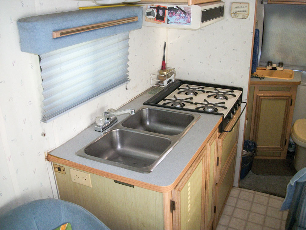 With a double sink and four-burner stove, the Micro Warrior's galley is compact and usable.