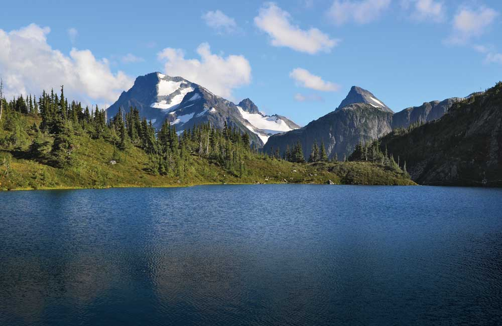 Pristine alpine lakes and soaring mountain peaks are just a sample of the natural attractions that await at the end of the road or ferry route.