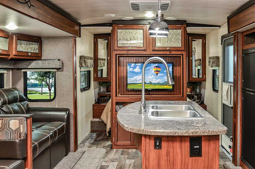 Heartland Wilderness RV living area with kitchen island and couch