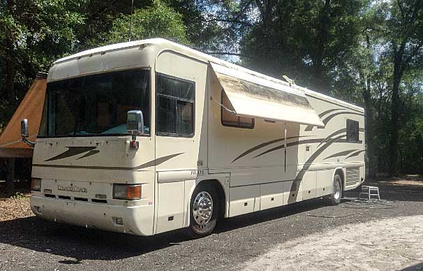 The 2000 Country Coach Intrigue with original decals and awning.