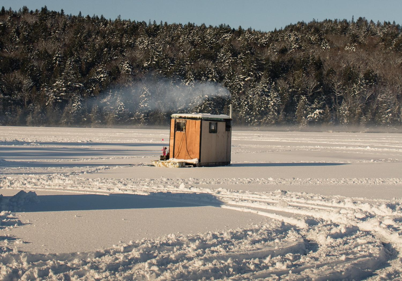 An ice house on a lake